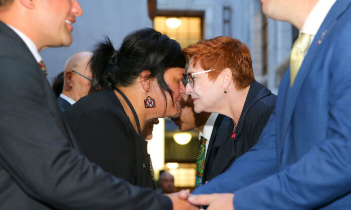 Australian Foreign Minister Marise Payne receives a hongi from Minister of Foreign Affairs Nanaia Mahuta during a Mihi Whakatau, or welcome speech, at Parliament in Wellington, New Zealand on April 22, 2021. (Hagen Hopkins/Getty Images)