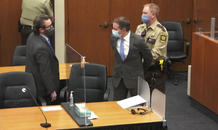 In this image from video, former Minneapolis police officer Derek Chauvin, center, is handcuffed as his lawyer Eric Nelson, left, watches, following the jury convicting Chauvin of three counts in the murder of George Floyd, in Hennepin County, Minn., on April 20, 2021. (Court TV via AP/Pool)