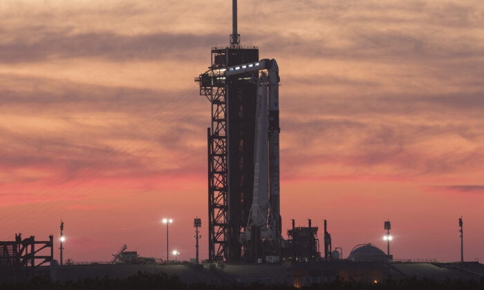 A SpaceX Falcon 9 rocket with the company's Crew Dragon spacecraft onboard sits on the launch pad at Launch Complex 39A at NASA's Kennedy Space Center in Cape Canaveral, Fla., at sunset on April 21, 2021. (NASA/Joel Kowsky)