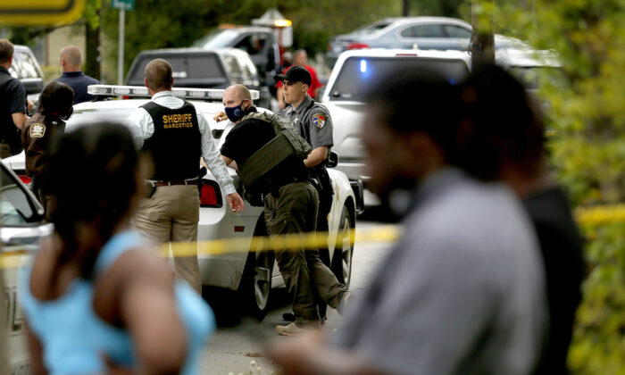 Law enforcement investigate the scene of a police-involved shooting, in Elizabeth City, N.C., on April 21, 2021. (Stephen M. Katz/The Virginian-Pilot via AP)