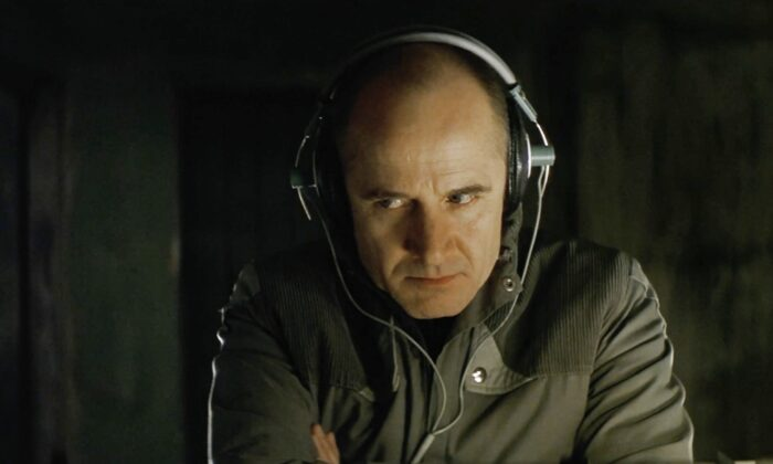 """A Stasi agent as depicted in the film """"The Lives of Others."""" (screenshot """"The Lives of Others""""/via The Epoch Times)"""