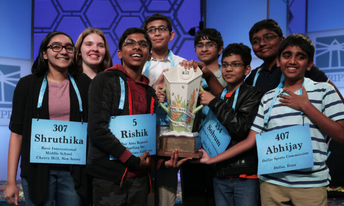 Co-champions (L-R) Shruthika Padhy (307) of Cherry Hill, N.J., Erin Howard (93) of Huntsville, Ala., Rishik Gandhasri (5) of San Jose, Calif., Christopher Serrao (427) of Whitehouse Station, N.J., Saketh Sundar (132) of Clarksville, Md., Sohum Sukhatankar (354) of Dallas, Texas, Rohan Raja (462) of Irving, Texas, and Abhijay Kodali (407) of Flower Mound, Texas, hold the trophy for photographers after 20 rounds of competition and won the championship of the Scripps National Spelling Bee at the Gaylord National Resort & Convention Center May 31, 2019, in National Harbor, Md. The winning spellers made history with the most number of co-champions in the spelling event history. (Alex Wong/Getty Images)