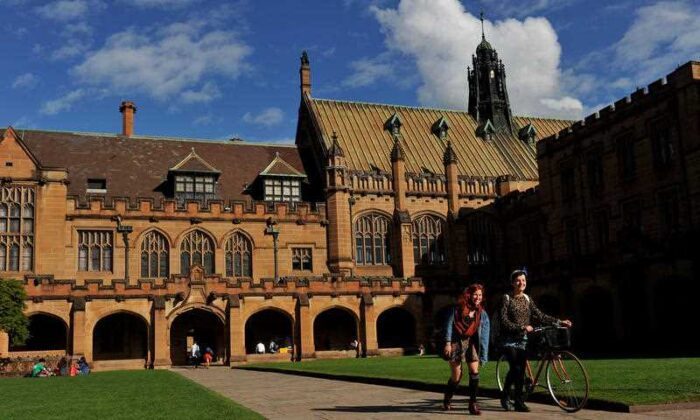 Students walk through The Quadrangle at The University of Sydney on May 8, 2013, on Sydney, Australia. (AAP Image/Paul Miller)