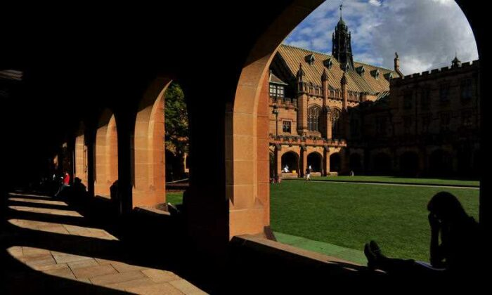 Students sit next to The Quadrangle at The University of Sydney on May 8, 2013, in Sydney, Australia (AAP Image/Paul Miller)