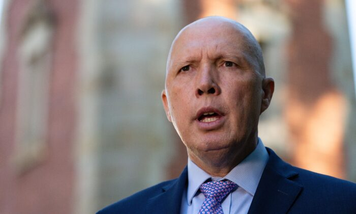 Australian Defence Minister Peter Dutton addresses media in front of the Subiaco War Memorial in Perth, Australia on April 19, 2021. (AAP Image/Richard Wainwright)