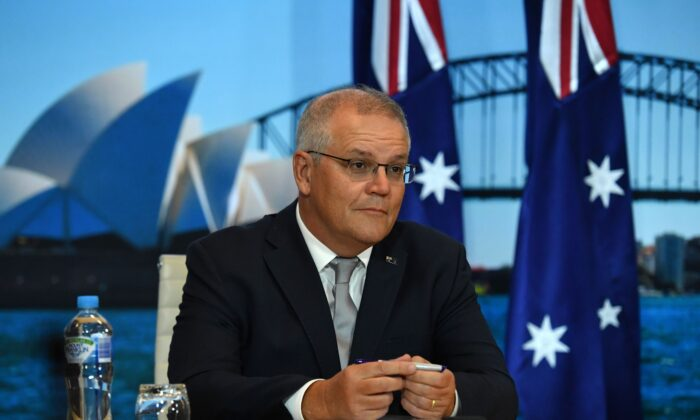 Prime Minister Scott Morrison looks on for the opening remarks of the Leaders Summit on Climate hosted by United States President Joe Biden, in Sydney, Australia on April 22, 2021. (AAP Image/Mick Tsikas)