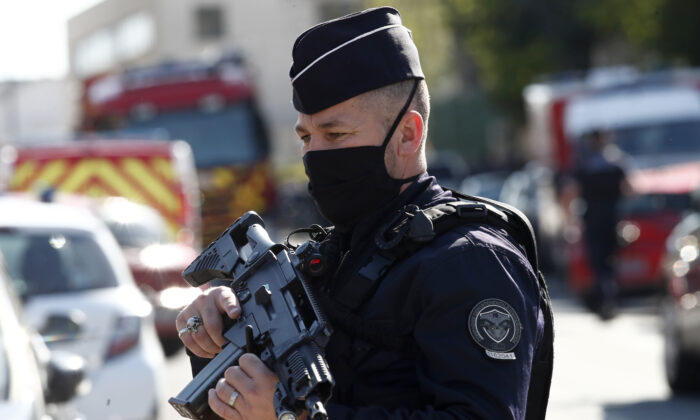Police officer blocks the access next to the Police station in Rambouillet, south west of Paris, on April 23, 2021. (Michel Euler/AP Photo)