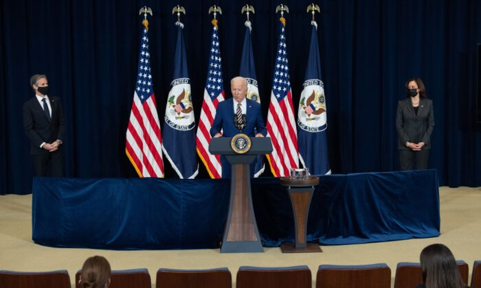President Joe Biden, with Secretary of State Antony Blinken (L) and Vice President Kamala Harris, speaks to the staff of the U.S. State Department during his first visit in Washington on Feb. 4, 2021. (Saul Loeb/AFP via Getty Images)