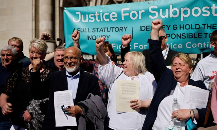 Former subpostmasters celebrate outside the Royal Courts of Justice in London, on April 23, 2021. (Tolga Akmen/AFP via Getty Images)