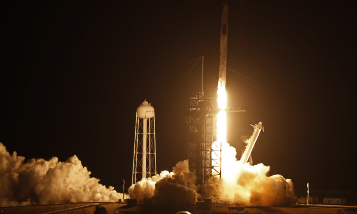 A SpaceX Falcon 9 rocket, with the Crew Dragon capsule, is launched carrying four astronauts on a NASA commercial crew mission to the International Space Station at Kennedy Space Center in Cape Canaveral, Fla., on April 23, 2021. (Joe Skipper/Reuters)