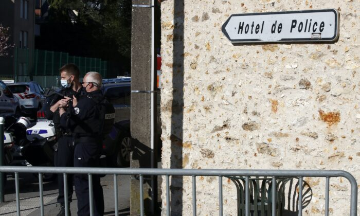 Police officers block the access next to the Police station in Rambouillet, south west of Paris, on April 23, 2021, after a 49-year-old female officer was stabbed to death inside the station by an Islamic extremist, who was shot and killed by police at the scene. (AP Photo/Michel Euler)