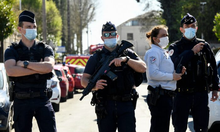 French police officials block off a street after a female police employee was stabbed to death by a Tunisian man at a police station in Rambouillet, southwest of Paris, on April 23, 2021. (Bertrand Guay/AFP via Getty Images)