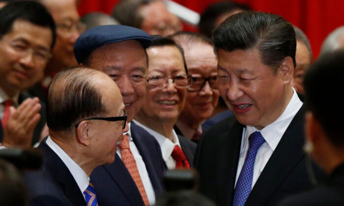 China's President Xi Jinping (R) is greeted by Hong Kong tycoon Li Ka-shing (L) before a photo session during Xi's visit in Hong Kong on June 30, 2017. (BOBBY YIP/AFP via Getty Images)