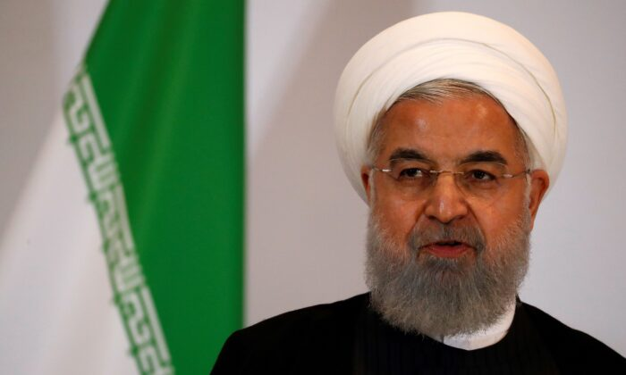 Iranian President Hassan Rouhani looks on as he attends a press conference in Bern, on July 3, 2018. (Ruben Sprich/AFP via Getty Images)