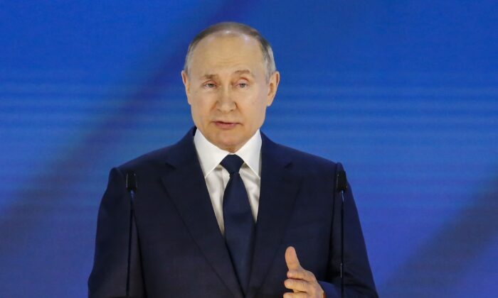 Russian President Vladimir Putin delivers his annual state of the nation address at The Federal Assembly at The Manezh Exhibition Hall in Moscow on April 21, 2021. (ALEXANDER ZEMLIANICHENKO/POOL/AFP via Getty Images)