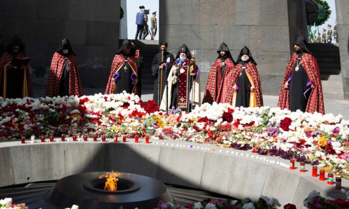 Armenian Apostolic Church leader Catholicos Garegin II (C) attends a memorial service at the monument to the victims of mass killings by Ottoman Turks, to commemorate the 106th anniversary of the massacre, in Yerevan, Armenia, on April 24, 2021. (Grigor Yepremyan/PAN Photo via AP)