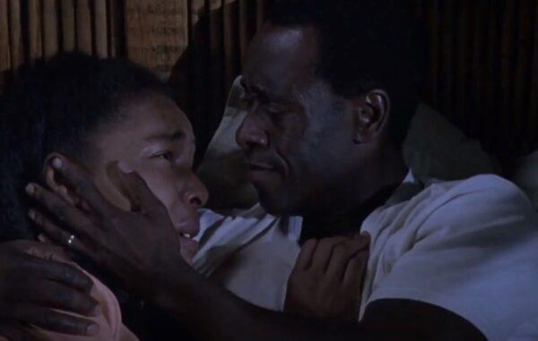 man comforting woman in Hotel Rwanda