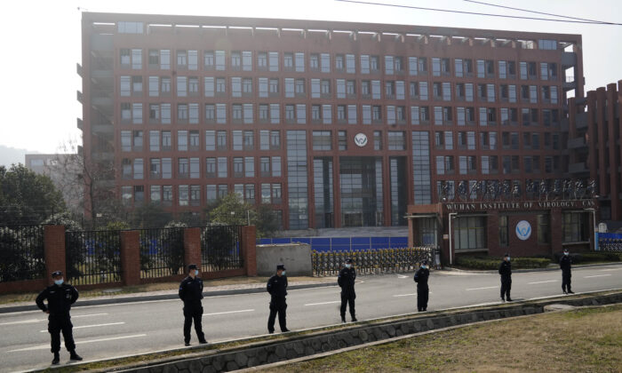 Security personnel gather near the entrance to the Wuhan Institute of Virology during a visit by the World Health Organization team in Wuhan, China, on Feb. 3, 2021. (Ng Han Guan/AP Photo)