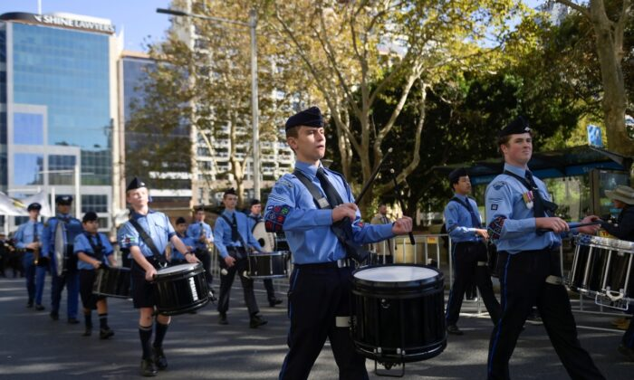 A uniformed services band performs as Australian military personnel, past and present, commemorate ANZAC Day during a march through the city centre in Sydney, Australia, on April 25, 2021. (Jaimi Joy/Reuters)