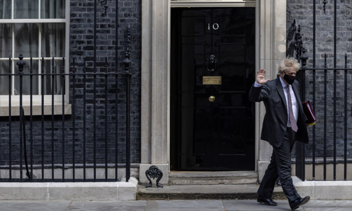UK Prime Minister Boris Johnson leaves 10 Downing Street to head to Parliament in London on April 21, 2021. (Rob Pinney/Getty Images)
