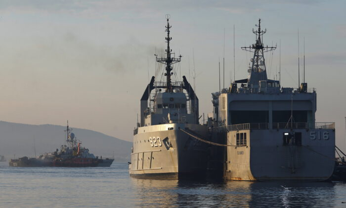 Indonesian Navy's ships at the Tanjung Wangi port as the search continues for the missing KRI Nanggala-402 submarine in Banyuwangi, East Java Province, Indonesia, on April 25, 2021. (Ajeng Dinar Ulfiana/Reuters)