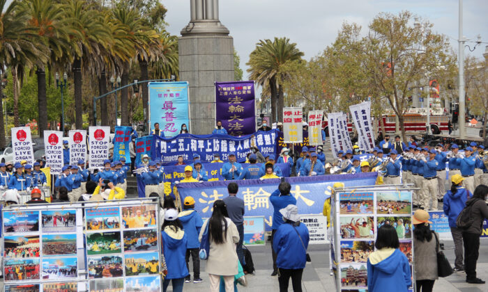 Falun Gong practitioners hold a rally in front of the Ferry Building in San Francisco on April 24, 2021, to raise awareness of the persecution happening in China. (David Lam/The Epoch Times)