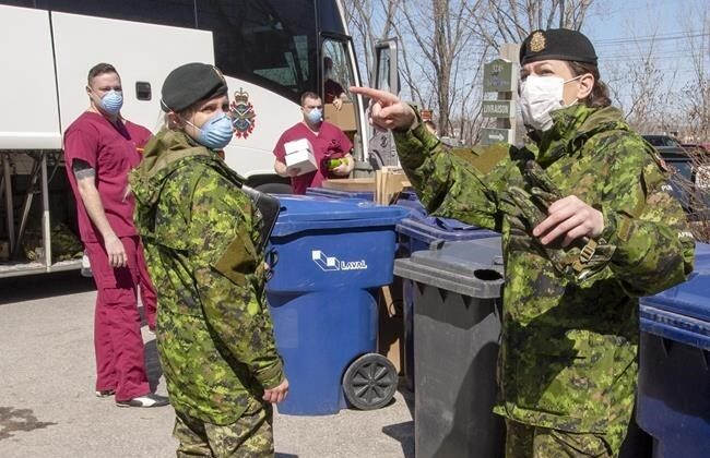 Canadian Armed Forces personnel arrive at the Villa Val des Arbes seniors residence, on April 20, 2020 in Laval, Quebec. (Ryan Remiorz/The Canadian Press)