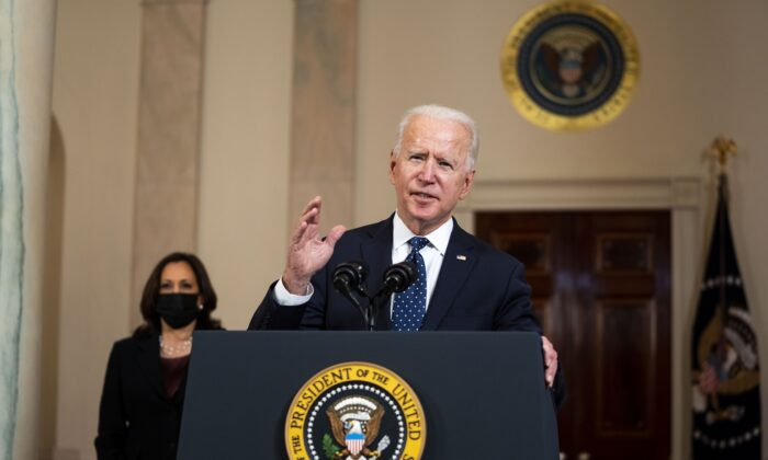 U.S. President Joe Biden makes remarks at the Cross Hall of the White House in Washington on April 20, 2021. (Doug Mills/Pool/Getty Images)
