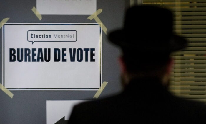 A man arrives at a polling station to cast his ballot in the Montreal municipal elections in Montreal, Canada, on Nov. 1, 2009. (Graham Hughes/The Canadian Press)