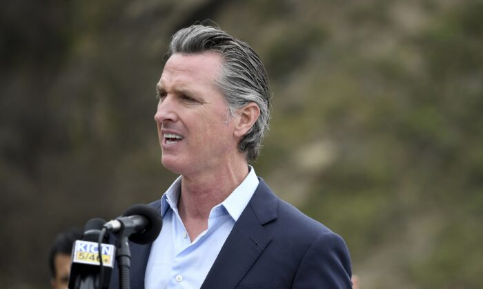 California Gov. Gavin Newsom speaks during a press conference about the newly reopened Highway 1 at Rat Creek near Big Sur, Calif., on April 23, 2021. (Nic Coury/AP Photo)