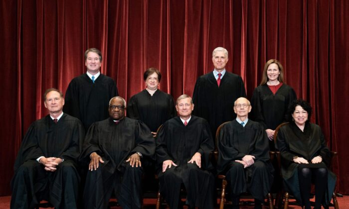 Seated from left: Associate Justice Samuel Alito, Associate Justice Clarence Thomas, Chief Justice John Roberts, Associate Justice Stephen Breyer and Associate Justice Sonia Sotomayor, standing from left: Associate Justice Brett Kavanaugh, Associate Justice Elena Kagan, Associate Justice Neil Gorsuch and Associate Justice Amy Coney Barrett pose during a group photo of the Justices at the Supreme Court in Washington, DC on April 23, 2021. (Erin Schaff/AFP)