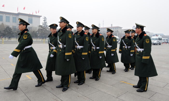 Chinese paramilitary police prepare to march on Tiananmen Square in Beijing on March 4, 2010. (Frederic J. Brown/AFP via Getty Images)