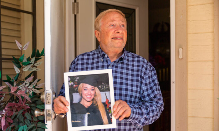 Moley Grossman holds a photo of his daughter, Lili, 36, who has been missing for two weeks. He is pictured in Mission Viejo, Calif., on April 26, 2021. (John Fredricks/The Epoch Times)