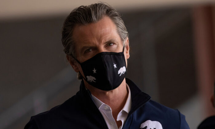 California Governor Gavin Newsom attends the opening of the country's first federal and state operated community vaccination site during the outbreak of the coronavirus disease (COVID-19) in Los Angeles, Calif., on Feb. 16, 2021. (Mike Blake/Reuters)