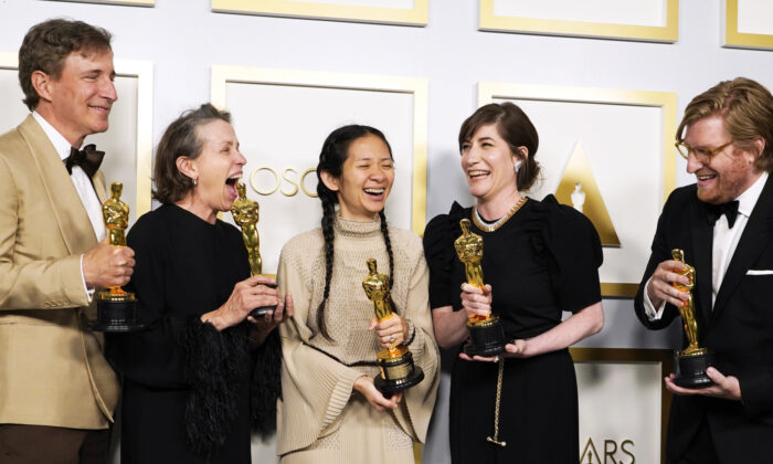 """From left, Peter Spears, Frances McDormand, Chloe Zhao, Mollye Asher and Dan Janvey, winners of the award for best picture for """"Nomadland,"""" pose in the press room at the Oscars at Union Station in Los Angeles on April 25, 2021. (Chris Pizzello, Pool/AP)"""
