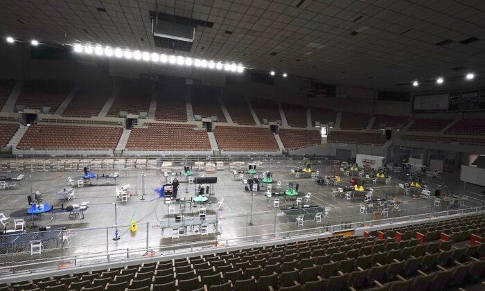 Ordered by the Republican-majority Arizona Senate, ballot scanning equipment is set up at the Arizona Veterans Memorial Coliseum in Phoenix, Arizona, on April 22, 2021. (Ross D. Franklin/AP Photo)