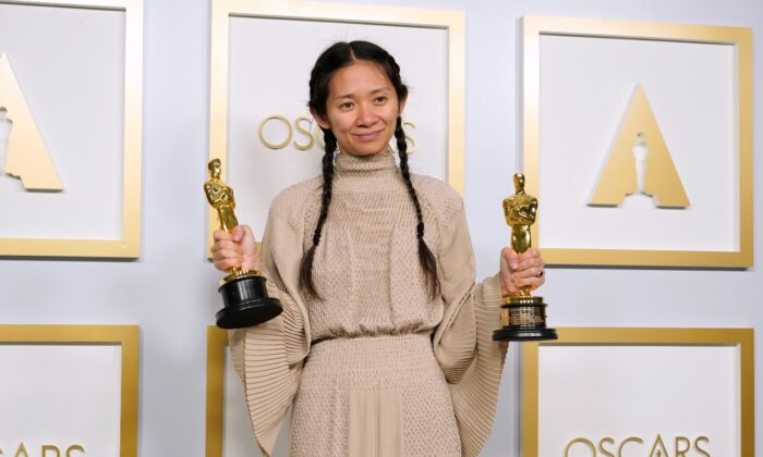 "Chloe Zhao, winner of the awards for best picture and director for ""Nomadland,"" poses in the press room at the Oscars at Union Station in Los Angeles, Calif., on April 25, 2021. (Chris Pizzello/Pool/AP Photo)"