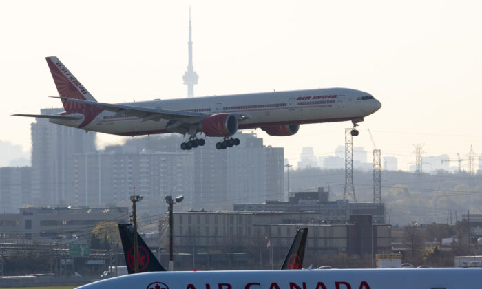 Air India flight 187 from New Delhi lands at Pearson Airport in Toronto on April 23, 2021. The flight was the last landing allowed after all flights from India and Pakistan to Canada were suspended. (The Canadian Press/Frank Gunn)