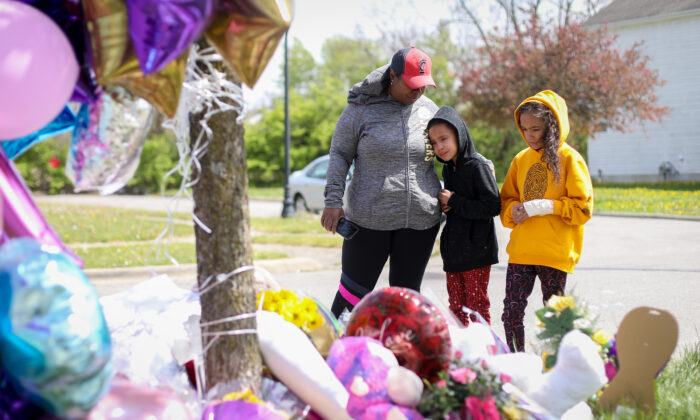 People at a memorial for Ma'Khia Bryant on Legion Lane, where a police officer shot the 16-year-old girl as she was attacking a woman with a knife, in Columbus, Ohio, on April 23, 2021. (Samira Bouaou/The Epoch Times)
