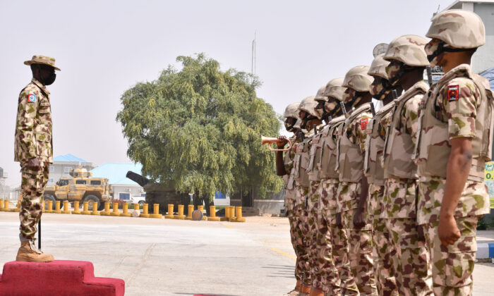 Soldiers stand at attention at the Maiduguri Airforce base in Maiduguri, Nigeria, on Jan. 31, 2021. (Audu Marte/AFP via Getty Images)