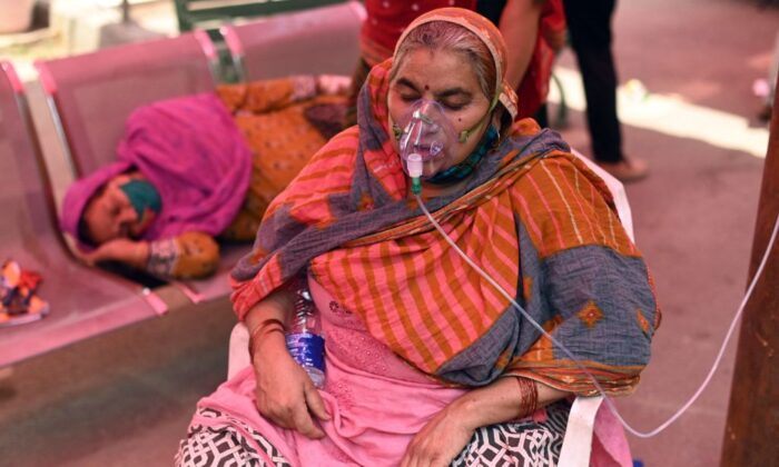 A patient breathes with the help of oxygen provided by a Gurdwara, a place of worship for Sikhs, under a tent installed along the roadside amid Covid-19 coronavirus pandemic in Ghaziabad on April 26, 2021. (Sajjad Hussain/Getty Images)