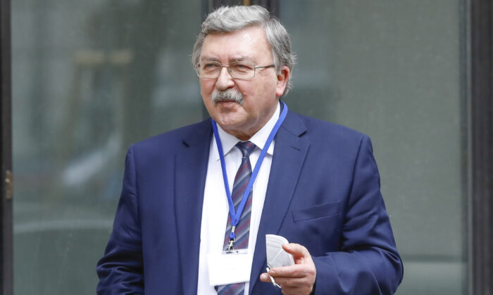 Russia's Governor to the International Atomic Energy Agency, IAEA, Mikhail Ulyanov is seen in front of the 'Grand Hotel Wien' where closed-door nuclear talks with Iran take place in Vienna, Austria, on April 20, 2021. (Lisa Leutner/AP Photo)