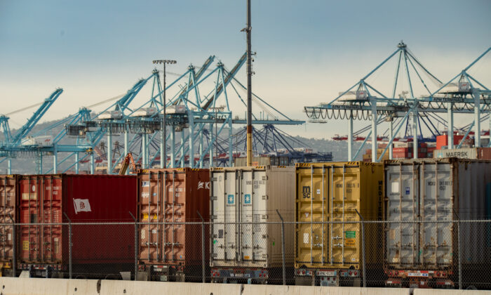 Shipping containers are loaded onto trucks at the Port of Los Angeles, in Long Beach, Calif., on Jan. 12, 2021. (John Fredricks/The Epoch Times)