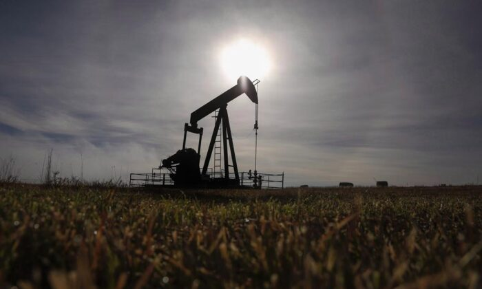 A pumpjack works at a well head on an oil and gas installation near Cremona, Alta., on Oct. 29, 2016. (Jeff McIntosh/The Canadian Press)
