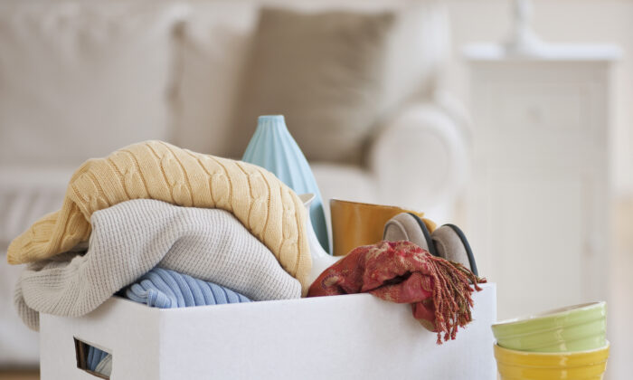 One of the easiest ways to clear clutter is to donate gently used items. (Tetra Images RF)
