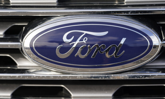 The blue oval logo of Ford Motor Company is shown in east Denver, Colo., on April 25, 2021. (David Zalubowski/AP Photo)