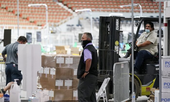 Some of the 2.1 million ballots cast during the 2020 election, are brought in for recounting at a 2020 election ballot audit ordered by the Arizona Senate at the Arizona Veterans Memorial Coliseum, in Phoenix, Arizona, on April 22, 2021. (Ross D. Franklin/AP Photo)