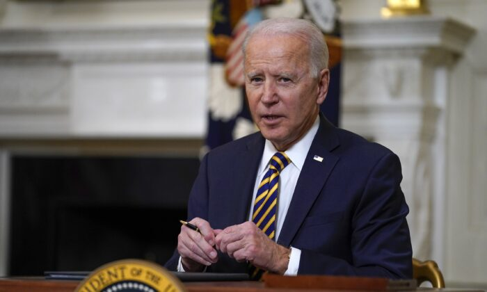 President Joe Biden pauses after signing an executive order relating to U.S. supply chains, in the State Dining Room of the White House in Washington on April 24, 2021. (Evan Vucci/AP Photo)