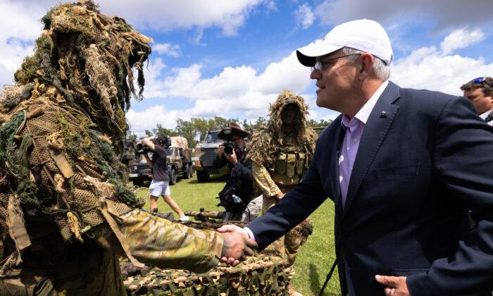 Prime Minister Scott Morrison during a visit to Australian Army base Robertson Barracks, in Darwin, Australia on April 28, 2021. (AAP Image/Charlie Bliss)
