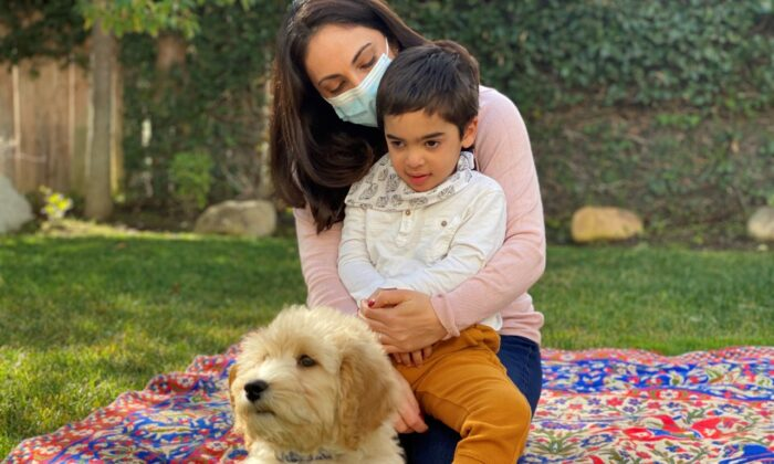 Darian Vakilil, four, is pictured with his mother Rojan and dog, Frank. (Submitted photo)